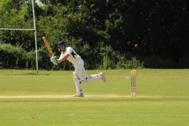 PhotoDinas 2nd XI player Aled Lewis on his way to a fine 119