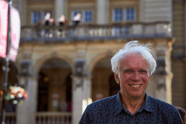 Ian Lawson in front of Cheltenham Town Hall while his fanfare is being played from the balcony. Picture: Still Moving Media, courtesy Cheltenham Music Festival