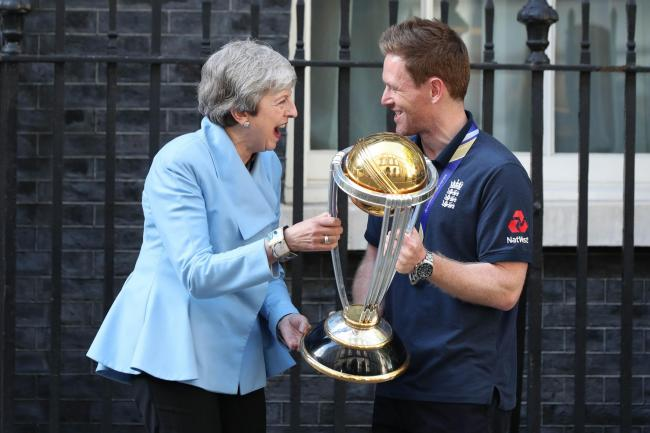 Theresa May with Eoin Morgan