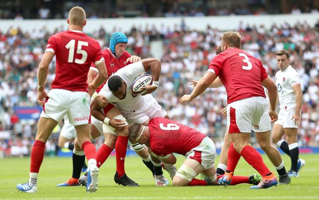 IMPRESSIVE: Aaron Wainwright, pictured tackling, caught the eye against England last weekend