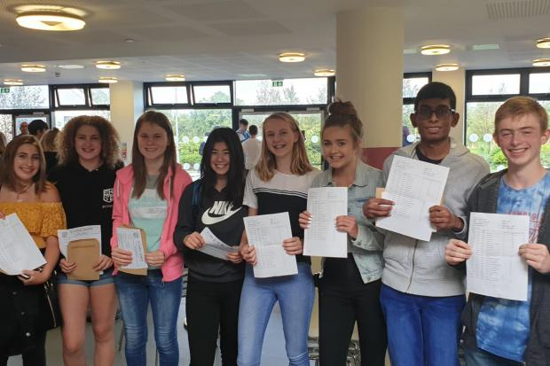 A group of happy pupils at St Cyres School, all of whom earned outstanding results