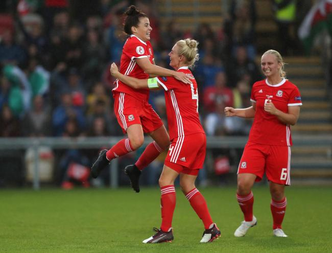 GOAL: Angharad James, left, celebrates after her shot was deflected in for the equaliser against Northern Ireland