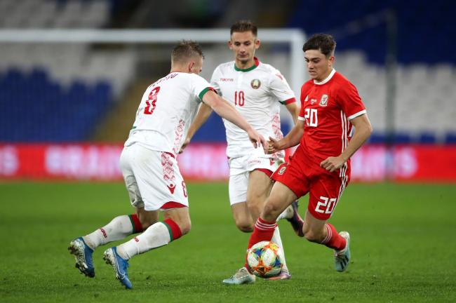 Belarus' Nikolai Zolotov challenges Wales' Daniel James during the International Friendly match at Cardiff City Stadium, Cardiff, Wales. PA Photo. Picture date: Monday September 9, 2019. See PA story SOCCER Wales. Photo credit should read: Nick P