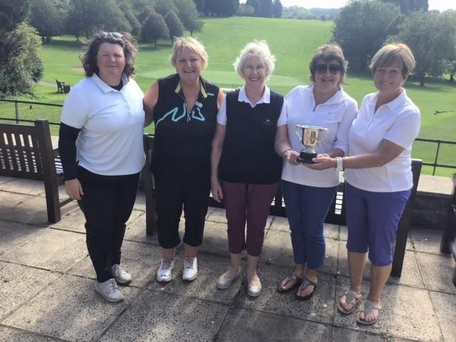 Lynda Lee presents the White Cup Foursomes trophy to winners Sue Dayananda and Lynda Hudd (to the right) and runners-up Lucy Sellick and Lynda Campbell