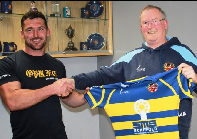 Vice chairman David James being presented with a shirt from blindside flanker and MD of Penarth-based Specialist Modular Scaffold, this season's shirt sponsor. Picture: Ken Langley