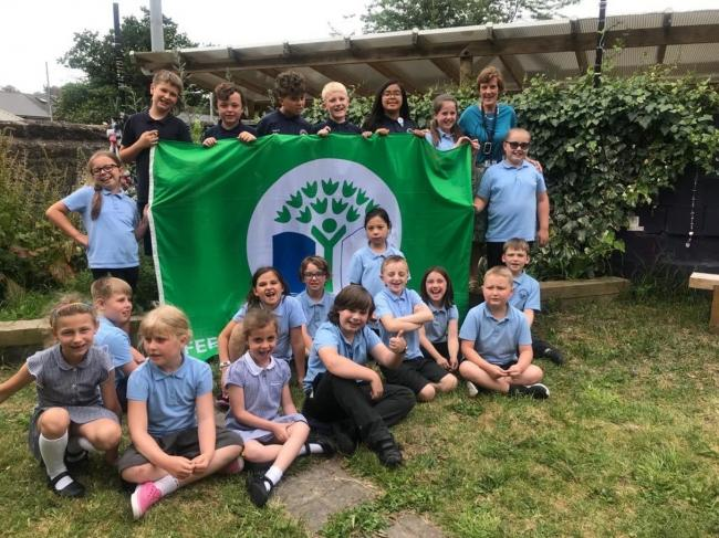 Cogan Primary students with their eco-flag