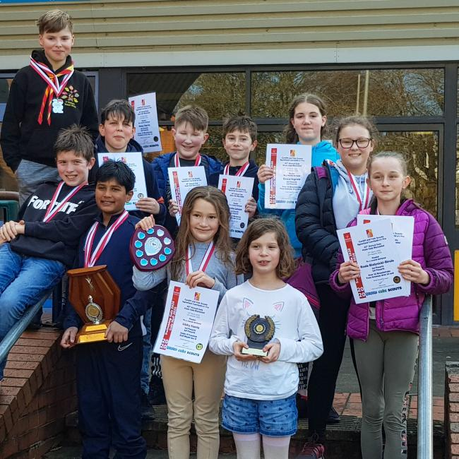 Some of the 2020 1st Penarth Scout Group Swimming Team with their certificates, medals and trophies