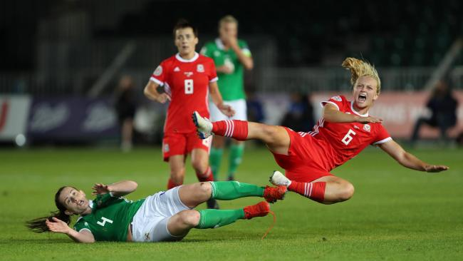 Wales' Elise Hughes is tackled by Northern Ireland's Sarah McFadden during the UEFA Women's Euro 2021 Qualifying Group C match at Rodney Parade, Newport..