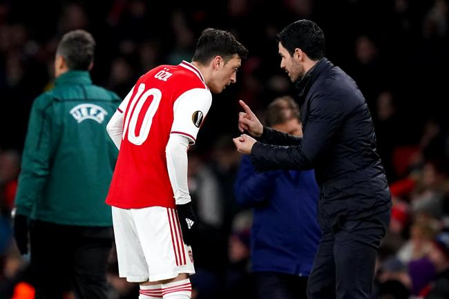 Arsenal manager Mikel Arteta, right, insists Mesut Ozil's wage does not impact his selection