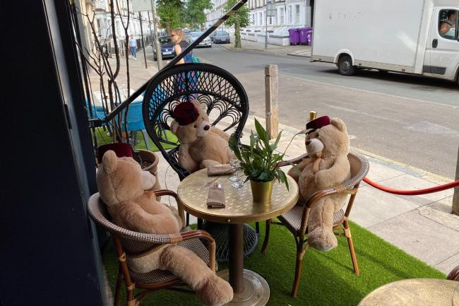 Cuddly toy bears sit in seats at Tagine in Balham to enforce social distancing at the restaurant