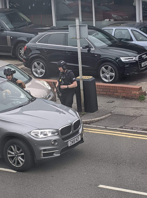 Two arrested and Redlands Road partially closed after police incident
