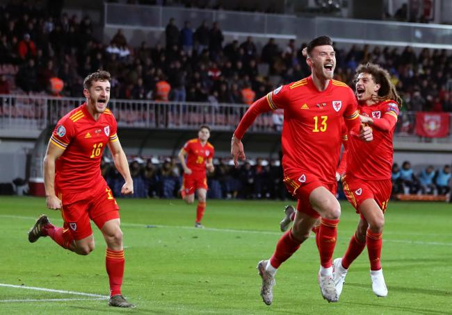 Wales' Kieffer Moore (centre) celebrates scoring his sides first goal of the game with teammates during the UEFA Euro 2020 Qualifying match at the Bakcell Arena, Baku..