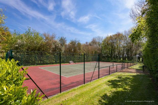 Penarth Times: The tennis court. Picture: Zoopla/Brinsons & Birt