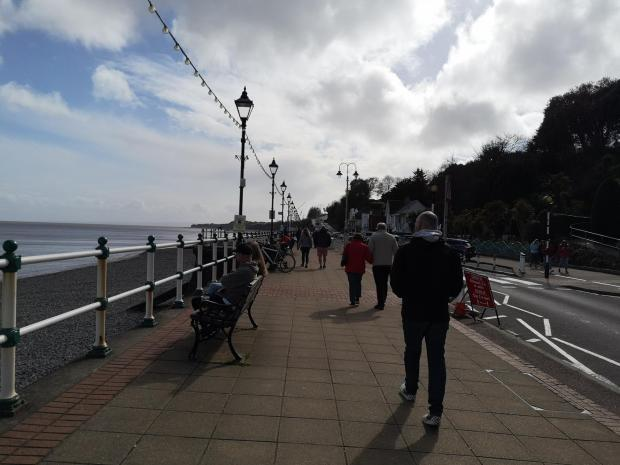 Penarth Times: People at Penarth seafront on Friday
