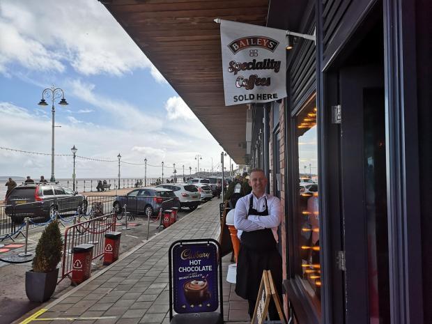 Penarth Times: Darren Lane outside Seasons bar at the Esplanade