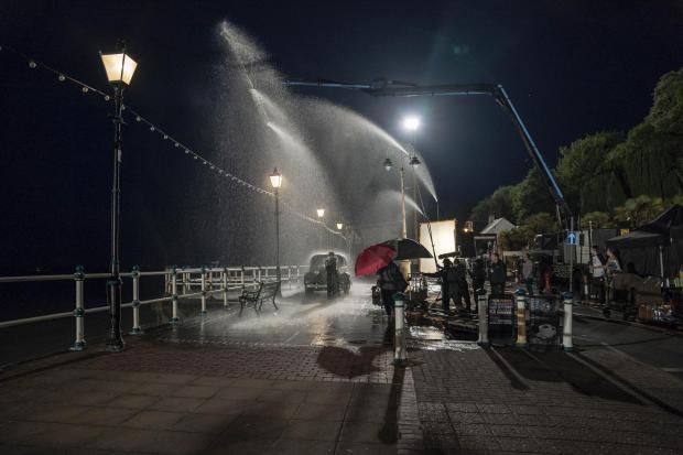 Penarth Times: A damp, dark evening on the pier. Picture: Amanda Searle Copyright © Reliance Entertainment Productions 6 Ltd 2019