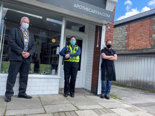 Penarth Times: L-R: Mayor Ian Buckley, PCO 55439 Sam Long of the neighbourhood policing team and Craig Parker.