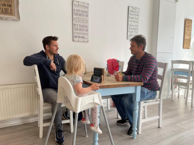 Penarth Times: L-R: Sion John, Alex Weeks and daughter Eleri Parry-Weeks enjoying some refreshments indoors at The Crepe Escape