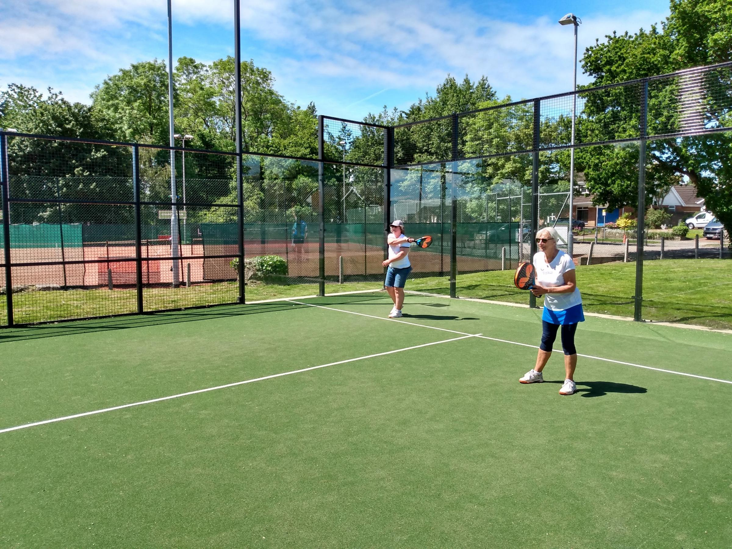 Alison Tranter (left) and Elaine Stevenson playing Padel Tennis at Windsor Lawn Tennis Club in Penarth.