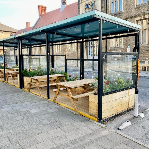 Penarth Times: The parklet outside Willmore's 1938 on Stanwell Road
