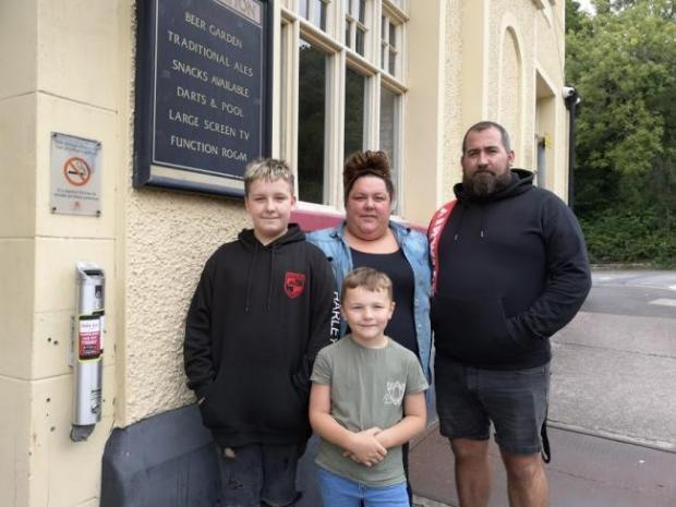 Penarth Times: Natasha Rees and her husband Gareth and sons Harley and Corey