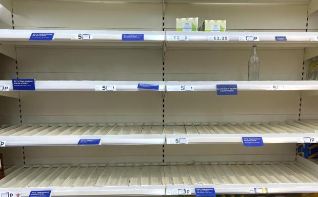 Penarth Times: Empty shelves at Tesco Supermarket in Penarth, South Wales on August 8. Credit: Huw Evans