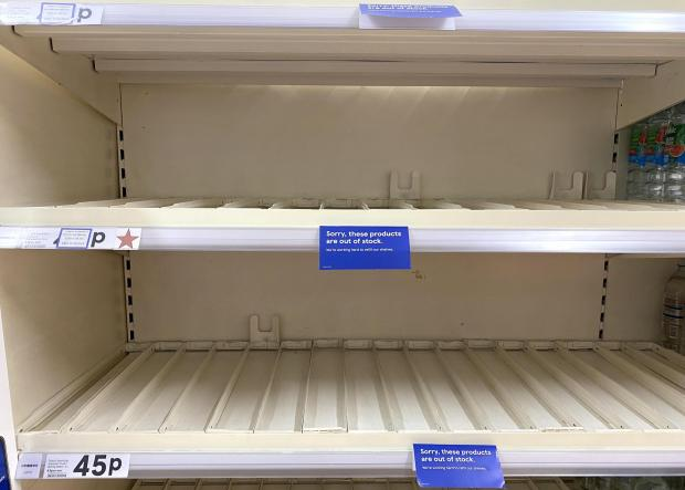 Penarth Times: 'Sorry, these products are out of stock' signs cover the shelves
