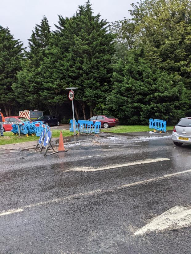Penarth Times: The burst pipe appears to have also distorted the road. Picture: Martin Chorley