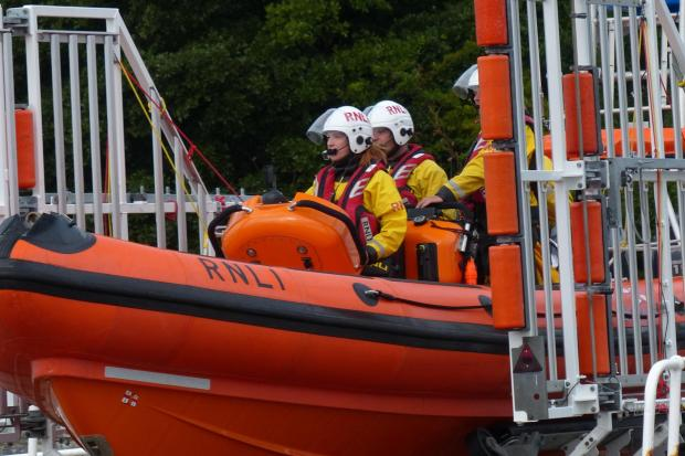 Penarth Times: Crew member Liv Quinn on board the Atlantic 85 lifeboat