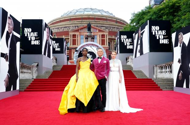 Penarth Times: Lashana Lynch, Daniel Craig and Lea Seydoux attending the World Premiere of No Time To Die, at the Royal Albert Hall in London. Credit: PA