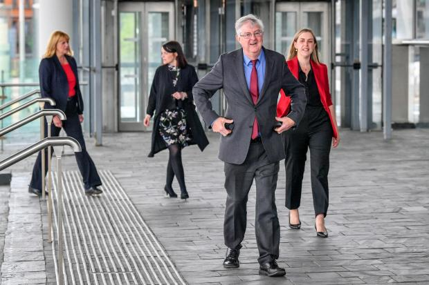 Penarth Times: Wales First Minister Mark Drakeford arrives at the Senedd in Cardiff Bay, Wales. Credit: PA