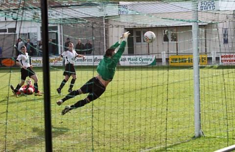 LATE EQUALISER: Alex Long (on the floor) looks on as his 93rd minute shot takes the tie into extra time.