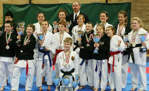 TROPHY WINNERS: Vale Karate members with their cups.