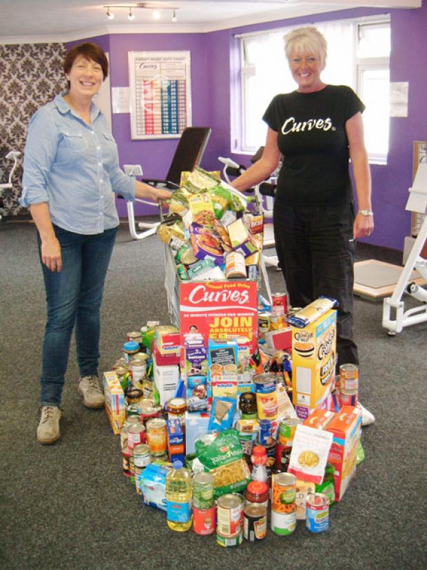 FOOD DRIVE: Sandra Mannings, circuit coach at Curves (right), with Claire Grafton from Tabernacle Church.