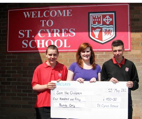 CONTRIBUTION: Charlie Mitchell and Nicholas Thomas presenting the cheque to Jess Evans.