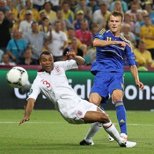 Ashley Cole (left) believes reaching the semi-finals of Euro 2012 is not enough for England