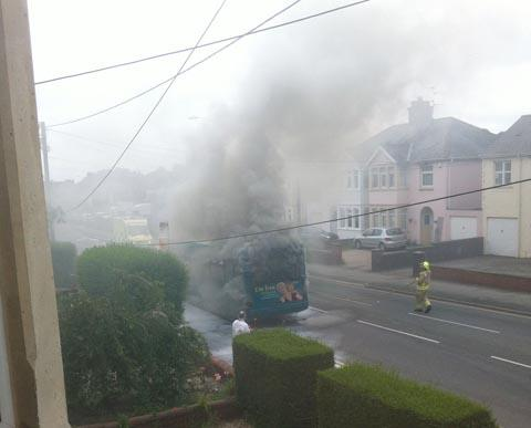 FIRE: Smoke billows from the Cardiff Bus.