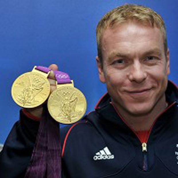 Sir Chris Hoy with his gold medals