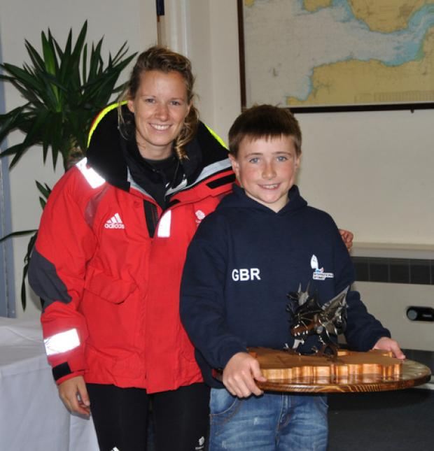 SAILING HERO: Hannah Mills presents Will Hall with his trophy