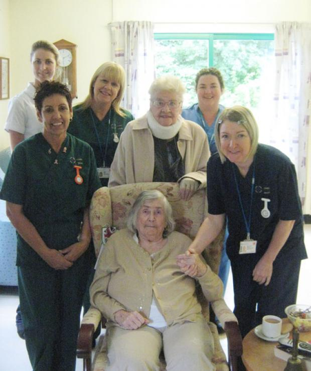 SITTING PRETTY: Penarth pensioner Joan Toye with staff at Barry Hospital and patient Margaret Simmons (sitting).