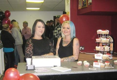 TATTOOER: Lisa Walker (right), pictured with her sister, has opened Inkabella on Plassey Street.