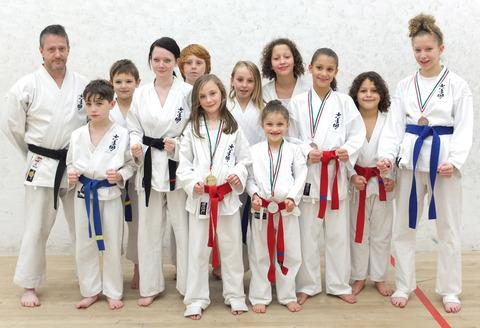 LEAGUE PERFORMERS: Eleven members who took part in the Welsh Karate League competition with assistant coach Keith Parsons. Medal winners were Jade Parsons, Leigha Godard, Keana Hutchinson, Trinty Hutchinson and Tylia Hutchinson.