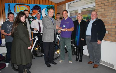 THANK YOU: Headteacher Chris Britten with David Murphy, Ian Liddiatt and Pam and Roy Stephens, alongside pupils from the school.