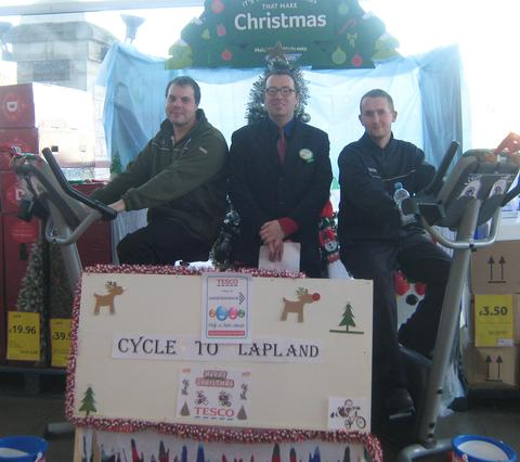 FESTIVE FUNDRAISING: Tesco staff members Chris McHugh and Damien Jones, with Mark Smith (centre).