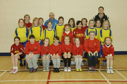 LEAGUE: Some of the pupils taking part in the Vale girls' football league, together with coaches Gino Esposito and Luke Williams.