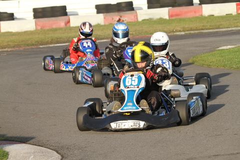 Eventual champion Ross Chell leads a close-fought Junior TKM battle at Llandow Kart Club's championship finale meeting. Picture: Hardy Rodde