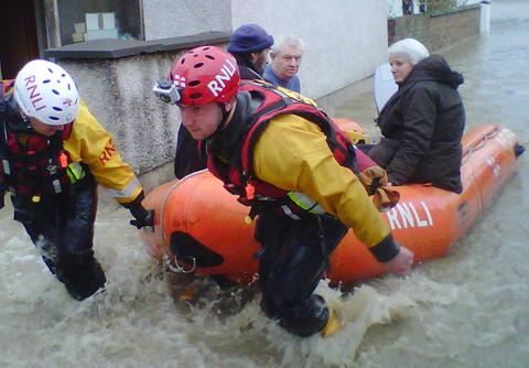 RESCUE: The RNLI Flood Rescue Team in action in St Asaph, North Wales.