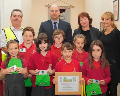 WINNER: Ella and Junior Road Safety Officers from Ysgol Pen y Garth, with John Rogers, Road Safety Officer; Allan Everett, director CelticAsh; Lis Burnett, Cabinet Member; and Clare Cameron, Principal Transport & Road Safety Officer.