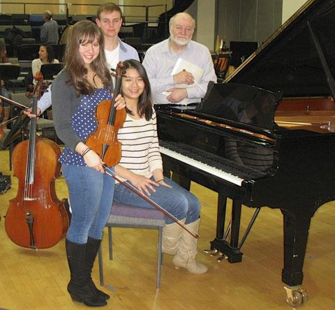 SOLOISTS: Juliette Roos, Ben Tarlton and Rosalind Phang with musical director Antony Tarlton during rehearsals