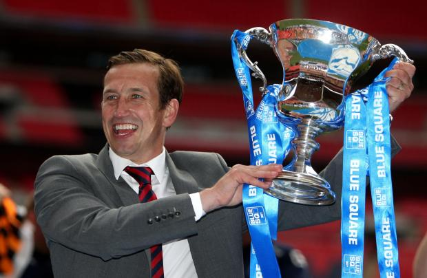 Penarth Times: Newport County's manager Justin Edinburgh celebrates with the trophy during the Blue Square Premier League Play-Off Final at Wembley Stadium, London. PRESS ASSOCIATION Photo. Picture date: Sunday May 5, 2013. See PA story SOCCER Wrexham. Photo credit